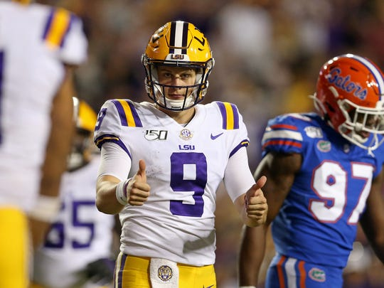Oct 12, 2019; Baton Rouge, LA, USA; LSU Tigers quarterback Joe Burrow (9) gestures after a touchdown in the second half against the Florida Gators at Tiger Stadium. Mandatory Credit: Chuck Cook-USA TODAY Sports