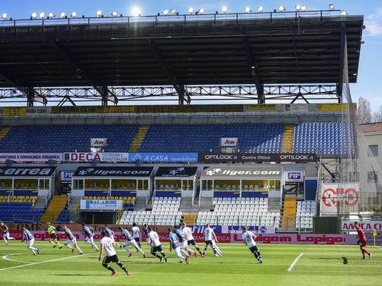 Parma and Spal play their Serie A soccer match in the empty Tardini stadium, in Parma, Italy, Sunday, March 8, 2020. Parma-Spal, the first match of the day, kicked off after a 75-minute delay inside an empty stadium as officials considered an appeal to suspend the games in Italy's top soccer division from sports minister Vincenzo Spadafora, minutes before the scheduled start. (Piero Cruciatti/LaPresse via AP)