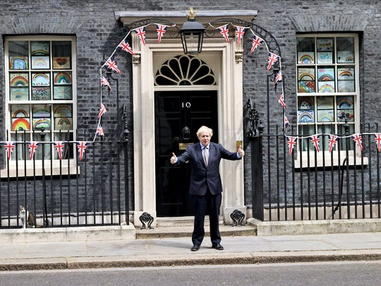 Britain's Prime Minister Boris Johnson poses for the media outside Downing Street, to mark the 75th anniversary of VE Day, in London, Friday, May 8, 2020. (Jon Bond/Pool Photo via AP)