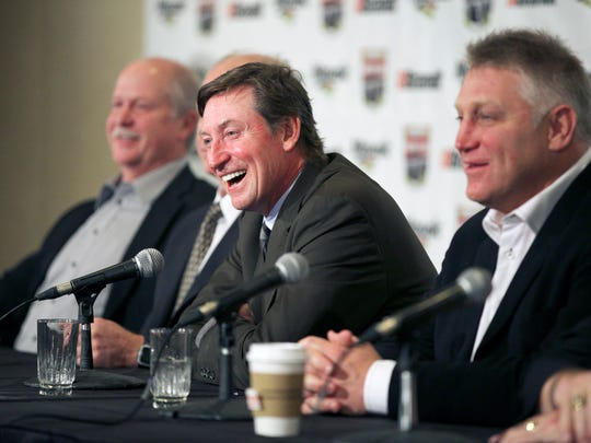 NHL hockey greats Wayne Gretzky (C) and Brett Hull (R) speak with the media ahead of a dinner honouring the life and career of Detroit Red Wings legend Gordie Howe in Saskatoon, Saskatchewan on February 6, 2015.