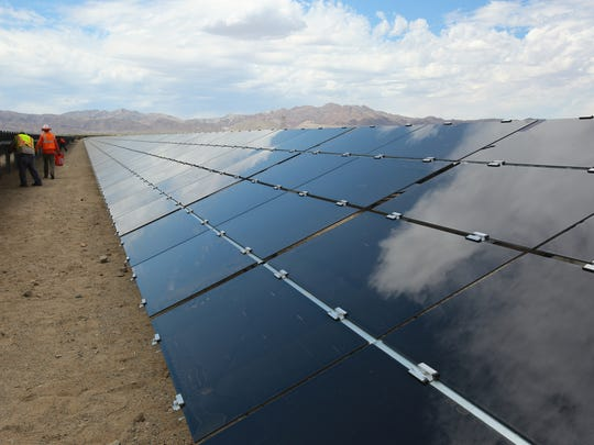 Workers build the 550-megawatt Desert Sunlight solar farm in Desert Center, about an hour east of the Coachella Valley, on Aug. 20, 2014.