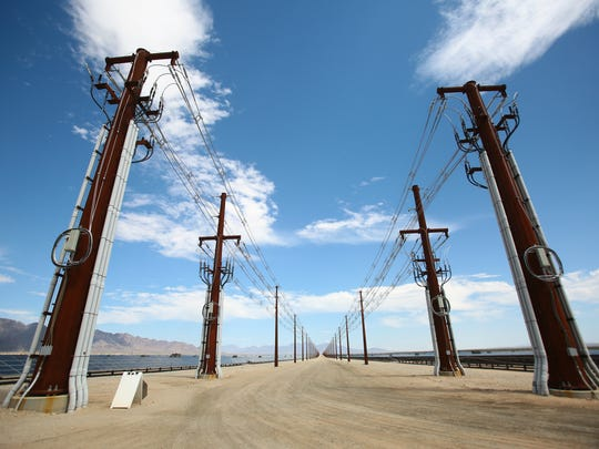 Overhead transmission lines funnel power underground to a nearby substation at the Desert Sunlight solar farm in Desert Center, Calif. on Wednesday, August 20, 2014. The project is expected to be fully operational in early 2015.
