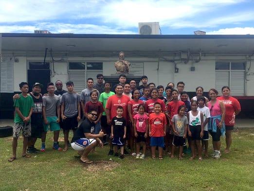 Volunteers representing several island basketball teams