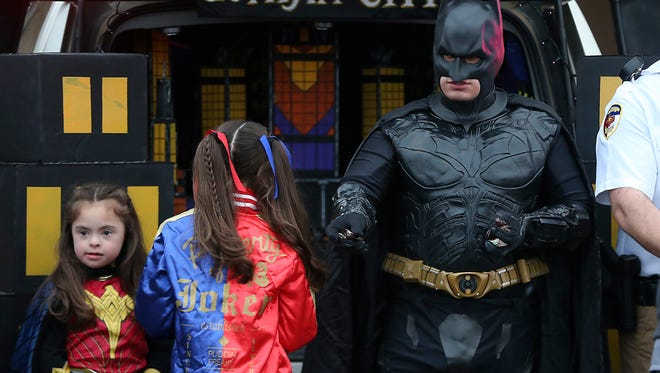 Batman hands out candy to trick-or-treaters during the Tom Green County Sheriff's Office's second annual HalloweenTrunk or Treat Tuesday, Oct. 31, 2017.