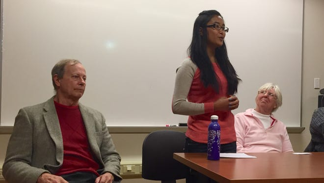 Fam Tial speaks Tuesday at an RIT forum about coming to Rochester as a refugee from Myanmar in 2008. With her are Mike Coniff of Rochester Refugee Resettlement Services and Kathy LaBue of Mary's Place Outreach.