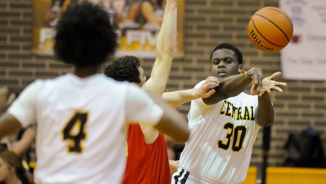 Joe Space, depicted playing basketball for Central, has signed to play football for Arizona Western.