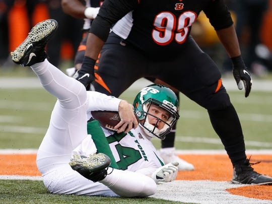 New York Jets quarterback Sam Darnold dives for extra yardage during the first half of an NFL football game against the Cincinnati Bengals, Sunday, Dec. 1, 2019, in Cincinnati. (AP Photo/Gary Landers)