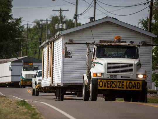 The Ohio Attorney General's office has said that the massive amount of evidence collection is unusual for their office, due to the fact that there were eight homicides at four different crime scenes. Here, two of the four homes where members of the Rhoden family are transported Thursday, May 12, 2016, from the Union Hill Road properties to a warehouse in Waverly, which is being used as a command center for authorities.