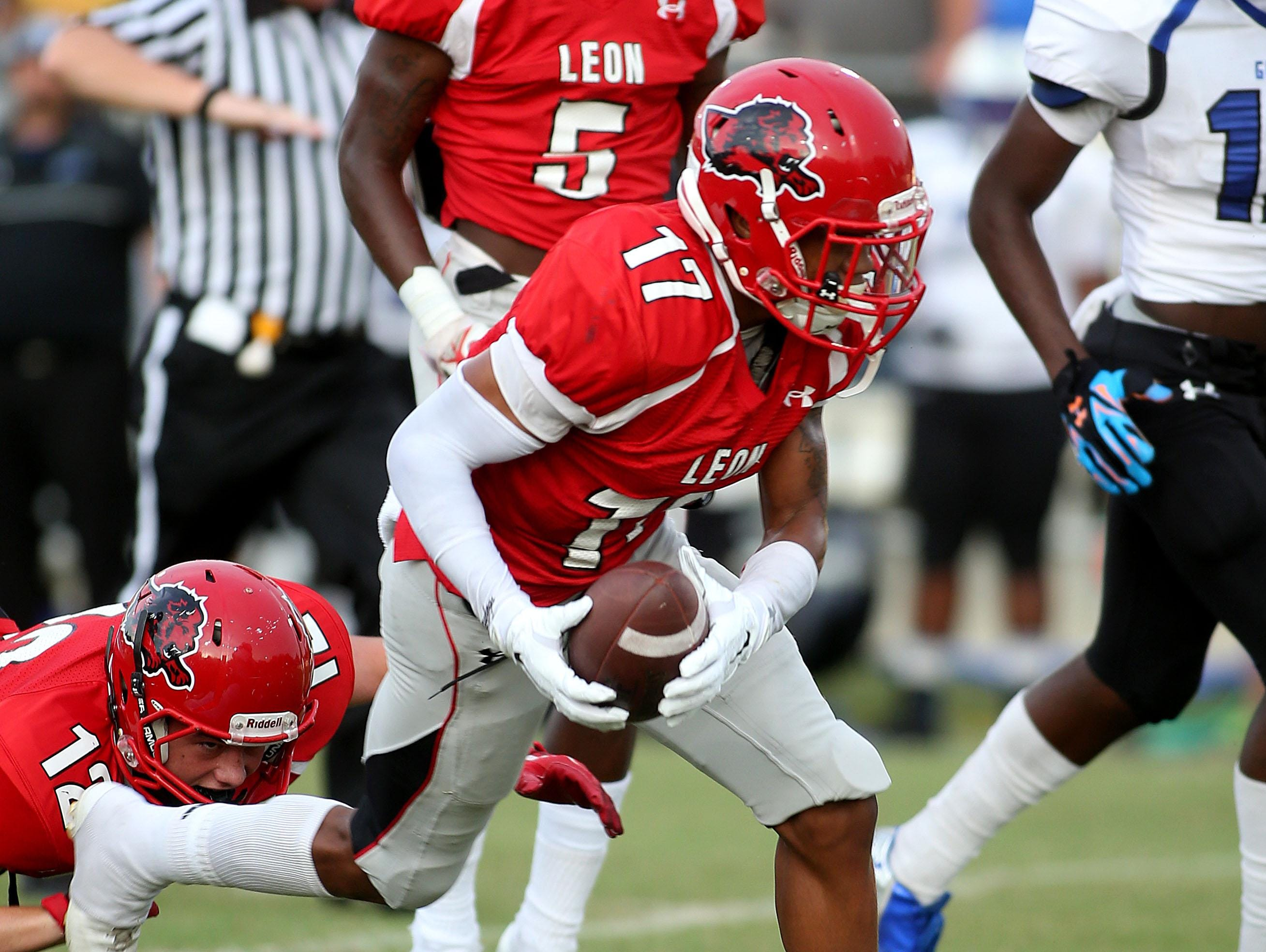 Leon's Damien Crumitie runs with the ball as the Godby Cougars roll past the Leon Lions at Gene Cox Stadium on Friday night.