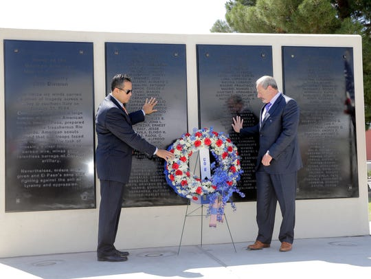 City Manager Tommy Gonzalez and then-Mayor Oscar Leeser place a wreath at the foot of the Rifle Company E of El Paso Memorial during a ceremony held in honor of those who served and those who gave their lives, as well as the surviving members of the rifle company.