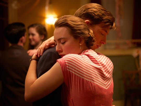 Saoirse Ronan (foreground) and Emory Cohen star in