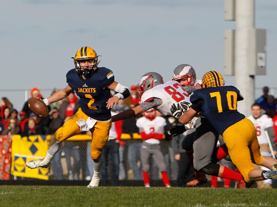 Yellowjackets QB Joey Bentley tries to scramble away from the Frankenmuth line but gets sacked Saturday, Nov. 12, 2016, at Ithaca.  Ithaca lost 28-20 for the time on their home field since 2009 and was the program's second loss since the start of the 2010 season.