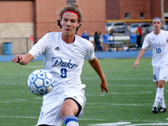 Whitefish Bay's Jackson Dryden takes control of the ball at home against Cedarburg on Oct. 5.