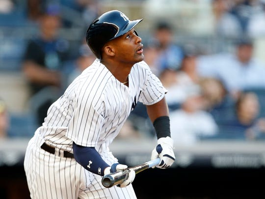 Jun 29, 2018; Bronx, NY, USA; New York Yankees third baseman Miguel Andujar (41) watches his RBI single against the Boston Red Sox during the second inning at Yankee Stadium.