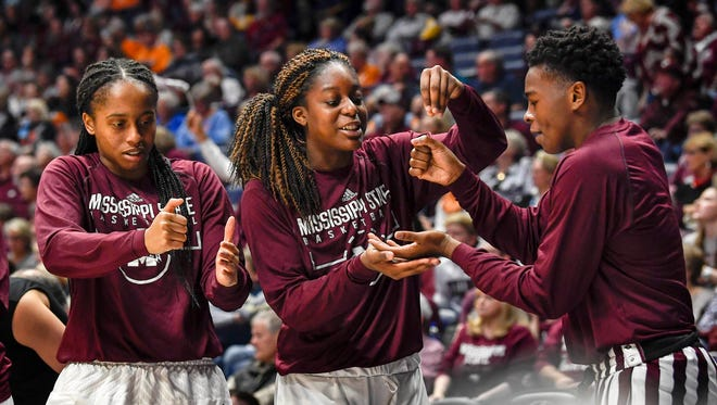 The Mississippi State Lady Bulldogs reacts to beating the Texas A&M Aggies by making a cake in the semifinals of the SEC Women's Basketball Tournament at the Bridgestone Arena in Nashville, Tenn., Saturday, March 3, 2018.