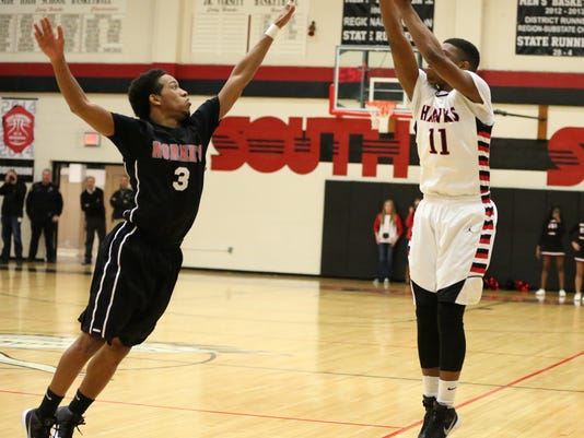 2 SS Chris McNeal shoots three against So Gibson Jordan Cobb Tuesday night a.JPG