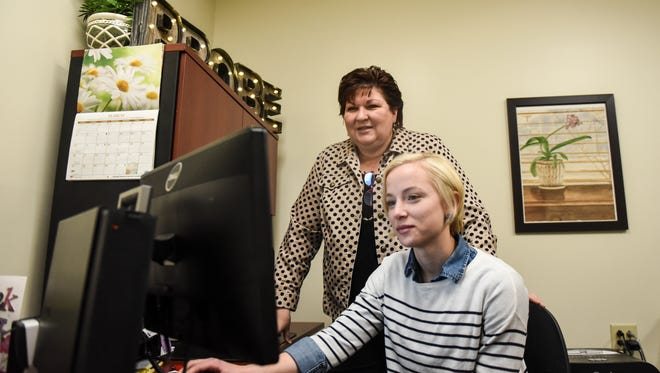 Director of PROBE Kathy Verna, left, and counselor Theresa Gassert are at work in PROBE's office at 303 Chestnut St., Lebanon, on Monday, March 28, 2016. PROBE will hold its 2016 anniversary breakfast buffet and silent auction on April 1 at the Hershey Country Club, 1000 E. Derry Road in Hershey.