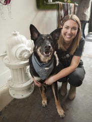 City Bark pet store owner Jamie Judson and her dog