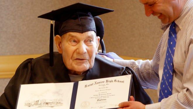World War II veteran Louis Schipper received his diploma from St. Xavier High School on Friday. Schipper left school when he was 17 to serve in the Navy.