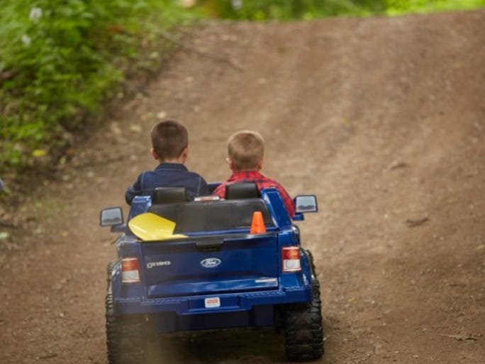 Two boys in the new Power Wheels version of the Ford F-150. It goes 5 mph.