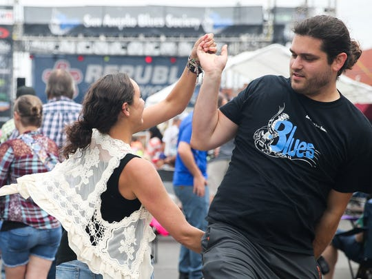 Tiana Hennings and Mark Hennings dance during the 2016 Simply Texas Blues Festival