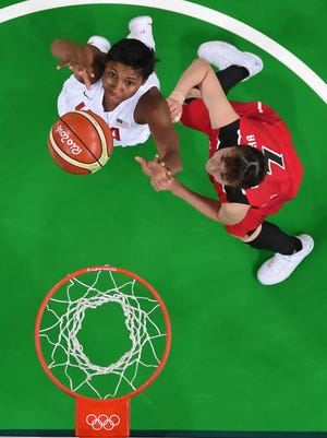 United States forward/guard Angel Mccoughtry (left) and Japan small forward Mika Kurihara look to rebound  during the USA's win on Tuesday.