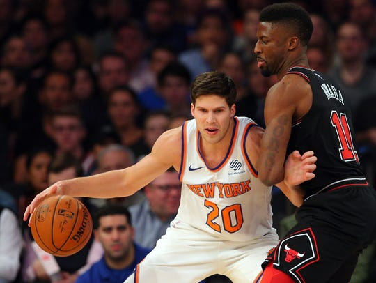 New York Knicks small forward Doug McDermott (20) controls