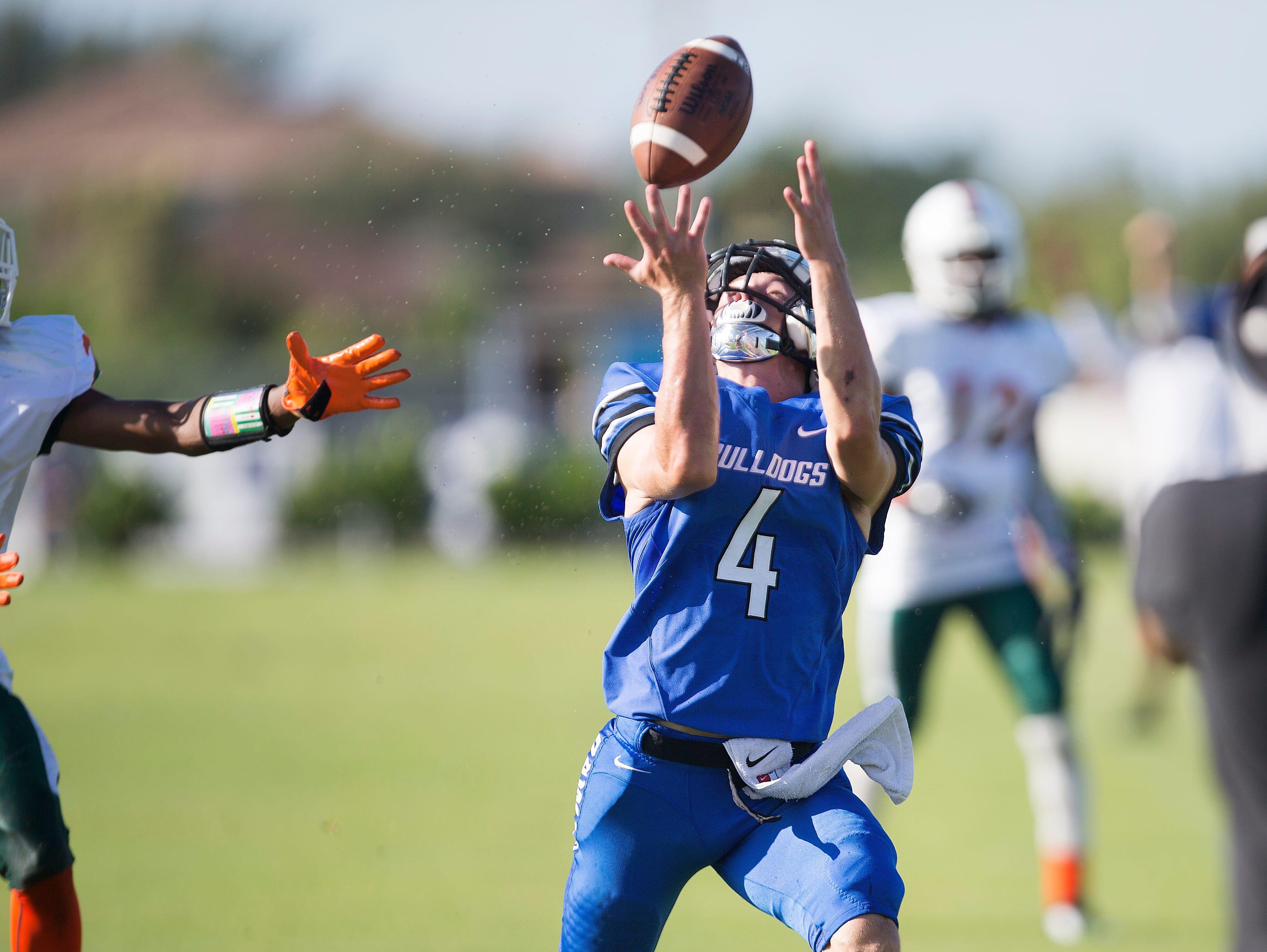 Ida Baker High School's Luke Endsley catches a touchdown Saturday against Dunbar at Ida Baker High School in Cape Coral.