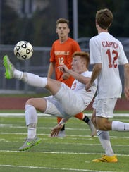 Canton's Jordan Percy (No. 3) does a bicycle kick while