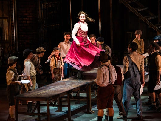 """Whitney Winfield dances on a table in character as Katherine in Tuacahn's 2017 production of """"Newsies."""""""