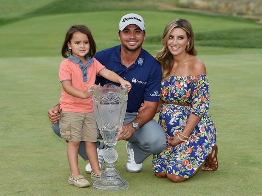 Jason Day is pictured with wife Ellie and son Dash after his victory at the Barclays in August.