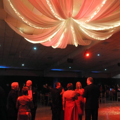 Guests visit under a soft canopy of light and fabric