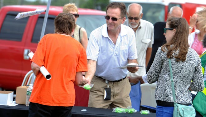 Sean Smith, of Gulf Power, hands out information Saturday during the 2014 Hurricane Preparedness day at Pensacola Community Maritime Park.