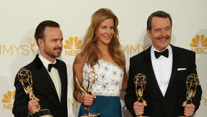 Aaron Paul, Anna Gunn and Bryan Cranston pose backstage at the Emmys.