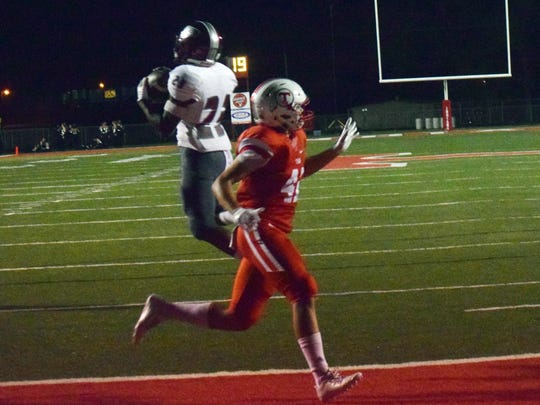 Pineville's Will Sands (23, left) intercepts a touchdown pass intended for Tioga's Detavius Eldridge (47, right).