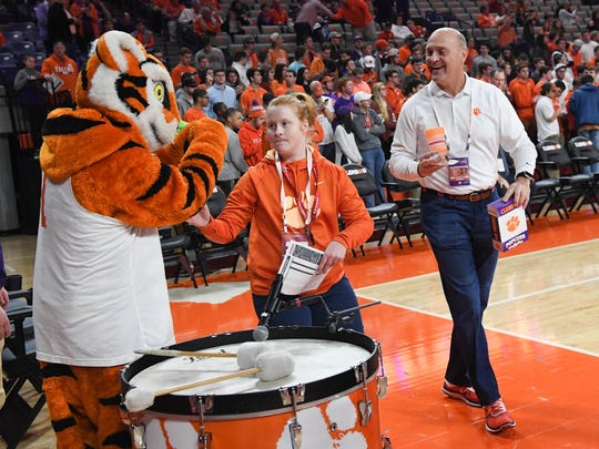 Clemson President Jim Clements watches as his daughter Grace greets the Tiger mascot before the Tigers play Miami at Littlejohn Coliseum in Clemson in January.