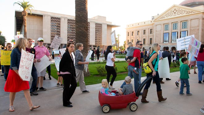 Protesters against K-12 and high education budget cuts gather at the Arizona state capital in Phoenix on March 5, 2015.