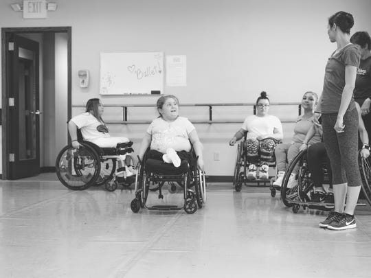 Students Jordyn Landowski, Gabi Berthiaume and Namine Eiche learn from physical therapist Diane Feldt and ballet dancer and teacher, Janel Meindersee.