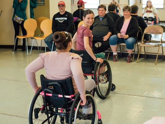 Milwaukee Ballet dancer and teacher, Janel Meindersee, tries out a wheelchair herself as she teaches her students.