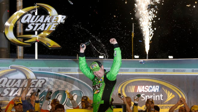 Kyle Busch wins the Quaker State 400 in 2015.