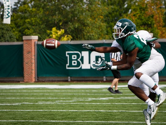 MSU CB Josiah Scott tries to block a pass intended
