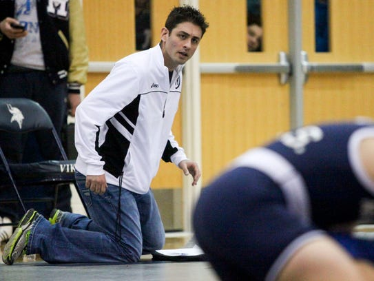 Marysville coach Rocky Palazzolo watches a wrestling