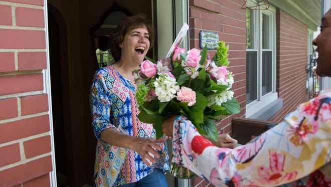 Judy Goldring opens up her front door in surprise as she's awarded Mom of the Year with a bouquet of flowers from Nanz and Kraft and gift cards. May 10, 2017.