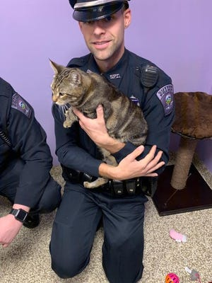 Sutton Police Officer Matthew Pepin at Second Chance Animal Services.