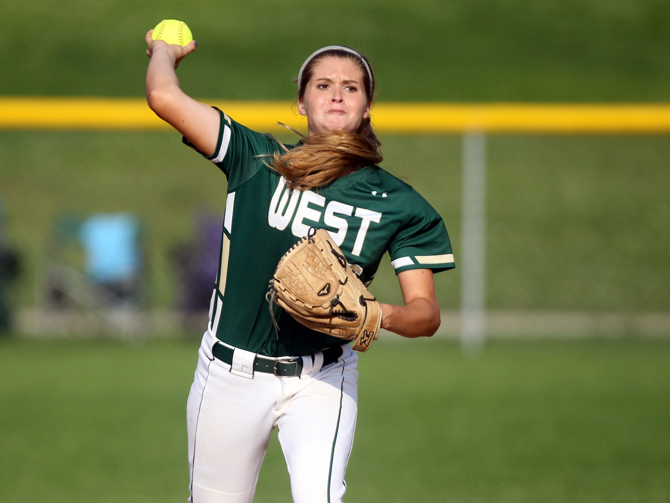 West High's Grace Tafolla throws to first base during the Women of Troy's game against Dubuque Senior on Thursday, June 25, 2015.