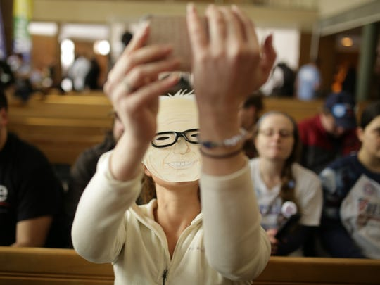 Kylee Fagan of Flint sports a Bernie Sanders mask while waiting for him to speak at Woodside Church in Flint on Thursday, Feb. 25, 2016, during a community forum.