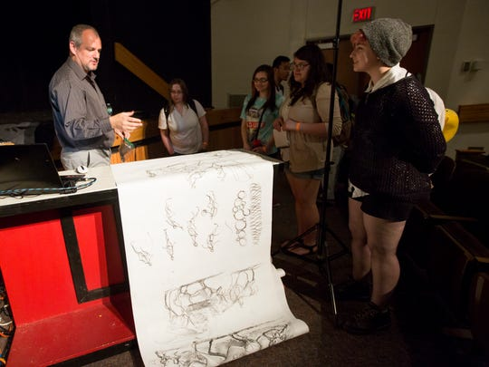 Graham Toms speaks to students after a demonstration of his drawing technique at Sprague High School on Monday, April 18, 2016. Toms will be teaching 3D digital art and video production at the Career and Technical Education Center in Salem beginning this fall.