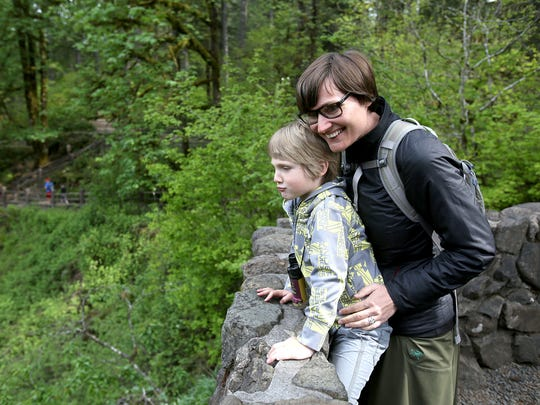 Pamela Power, of Portland, and her 4-year-old son, Hugo, take in the view of the main falls on Mother's Day at Silver Falls State Park in 2015.