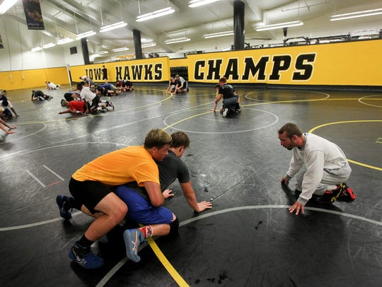 Former Hawkeye Dan Dennis works with Alex Teeter, 17,