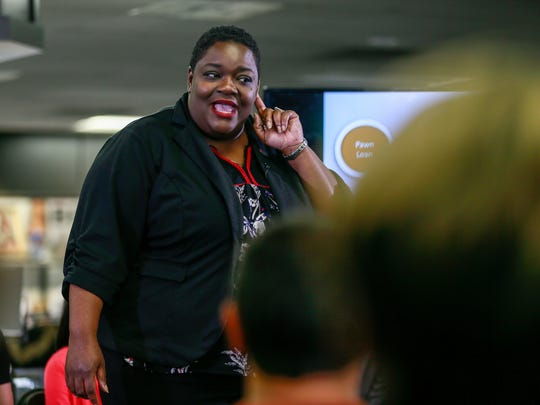 Crystal Nickson, 37, is a financial well-being coach with Operation HOPE in northwest Detroit, gives advice about loans, during the Financial Literacy for Alternative Lending Customers presentation hosted by American Jewelry and Loan in Detroit on Tuesday, Oct. 25, 2016.